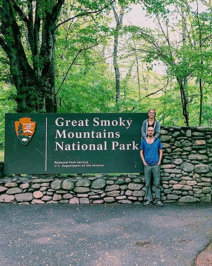 Standing by the sign at the beautiful entrance to Great Smoky Mountains National Park in North Carolina