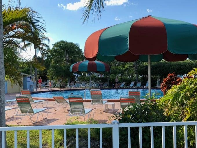 Cool off and relax under a large umbrella at the fantastic Miami Everglades RV Resort pool.