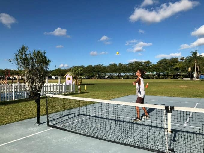 Young man enjoys a game of pickleball at Miami Everglades RV Resort, a Miami RV park.