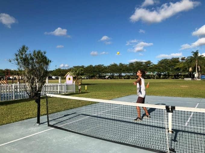Young man enjoys a game of pickleball at Miami Everglades RV Resort, a Miami RV park.