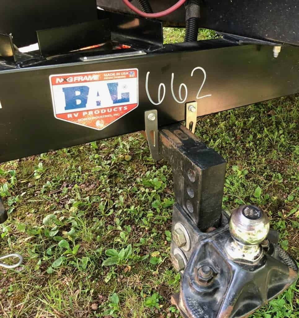 The HITCHPORT Hitch Bar Storage Mount installed on my Keystone Passport Travel Trailer. A simple and inexpensive solution to help you avoid back pain and injury.