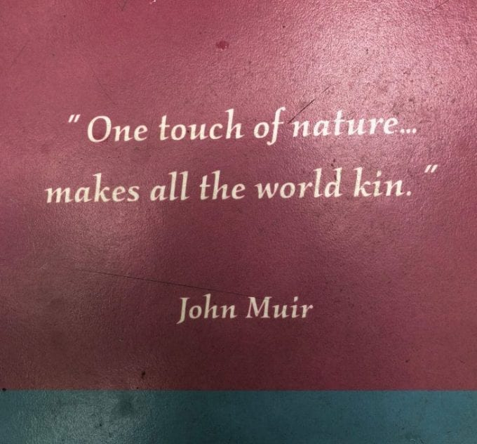 "John Muir quote on a sign at Acadia National Park, Maine: ""One touch of nature...makes all the world kin."""
