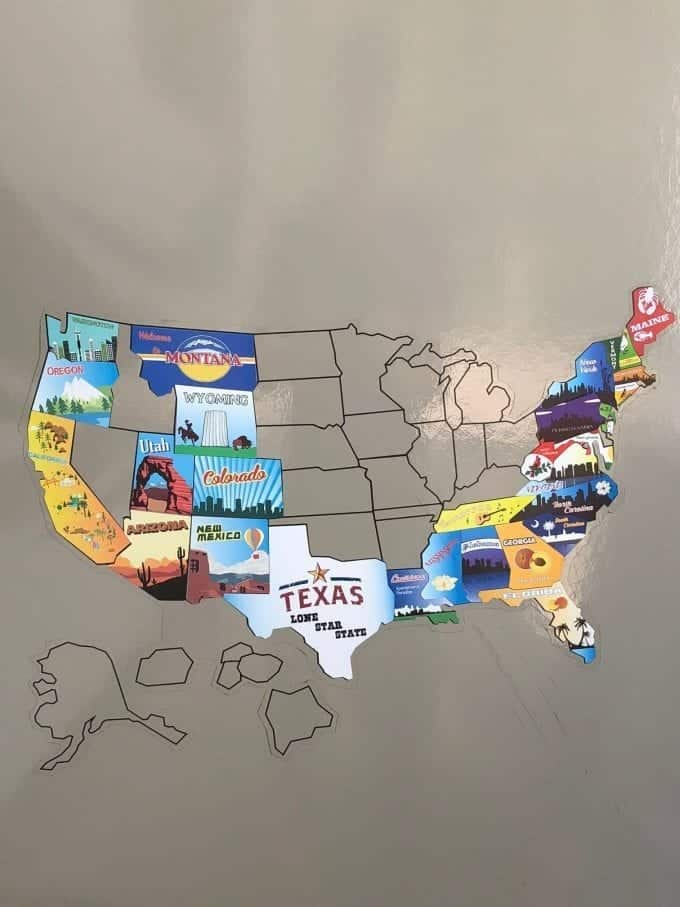 A map of the United States, on the slide of our travel trailer, that shows all of the states we have visited during our 13 months of full time rv living.