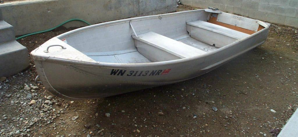 Small aluminum boat, similar to the one I lifted that fateful Sunday morning, that began my troubles with back pain.