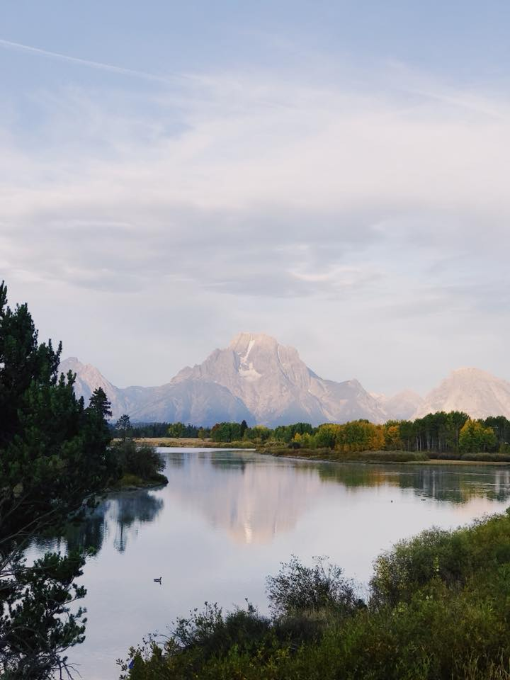 A mountain reflecting in the water early in the morning in Grand Teton National Park.