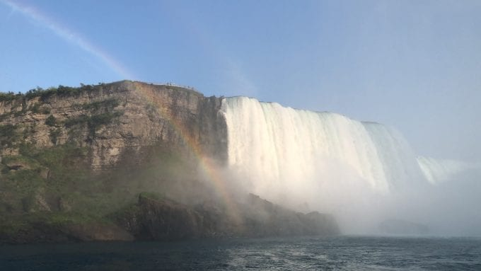 Beginning of Horseshoe Falls (US side) from Niagara Gorge with a rainbow adding the perfect touch to the scene at Niagara Falls New York.