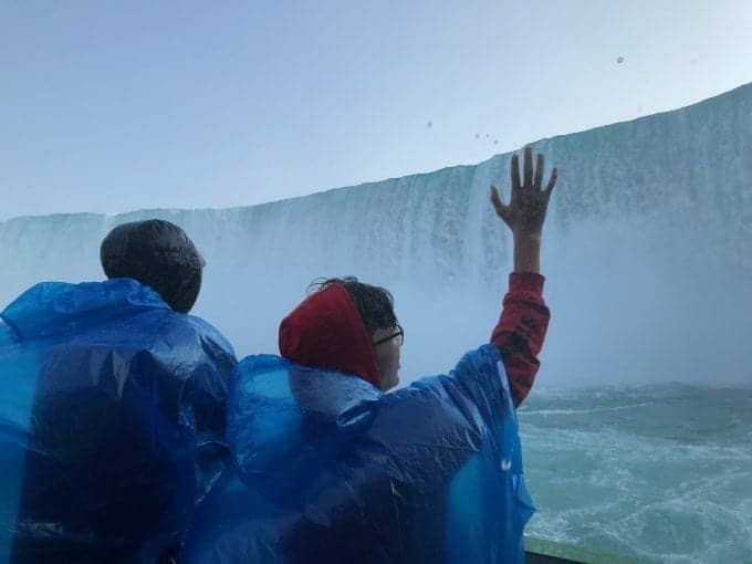 Riding the Maid of the Mist tour boat into the middle of Horseshoe Falls at Niagara Falls New York