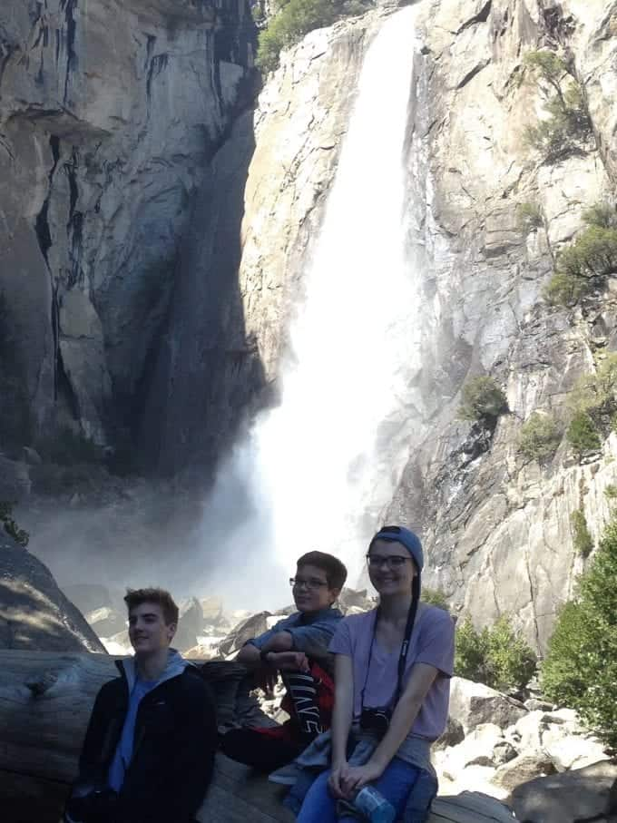 My three kids in front of a beautiful waterfall in Yosemite National Park in the Spring.