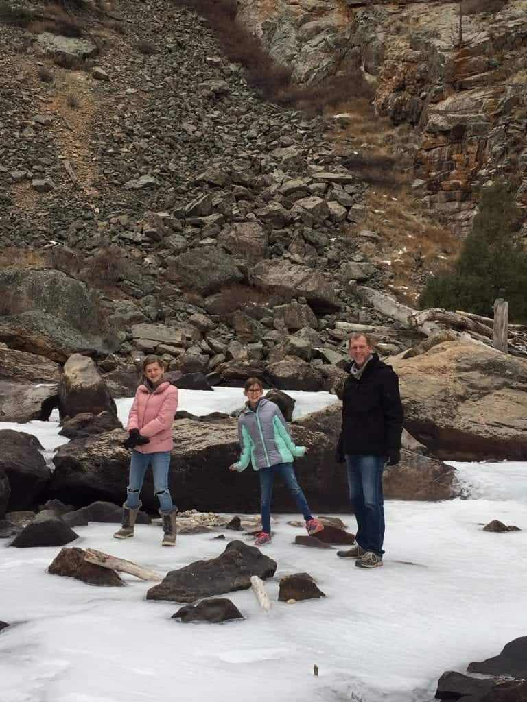 Playing on the frozen river in Poudre Canyon
