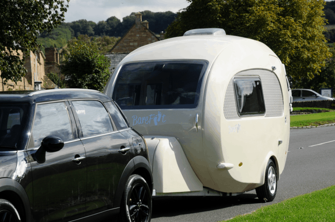 The Barefoot trailer in-tow behind a Mini Cooper vehicle, showing it is very easily towable by most SUVs and crossovers.