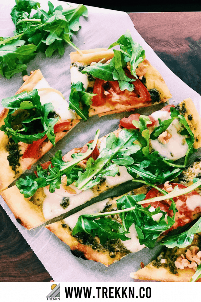 Naan pizza recipe with pesto and arugula