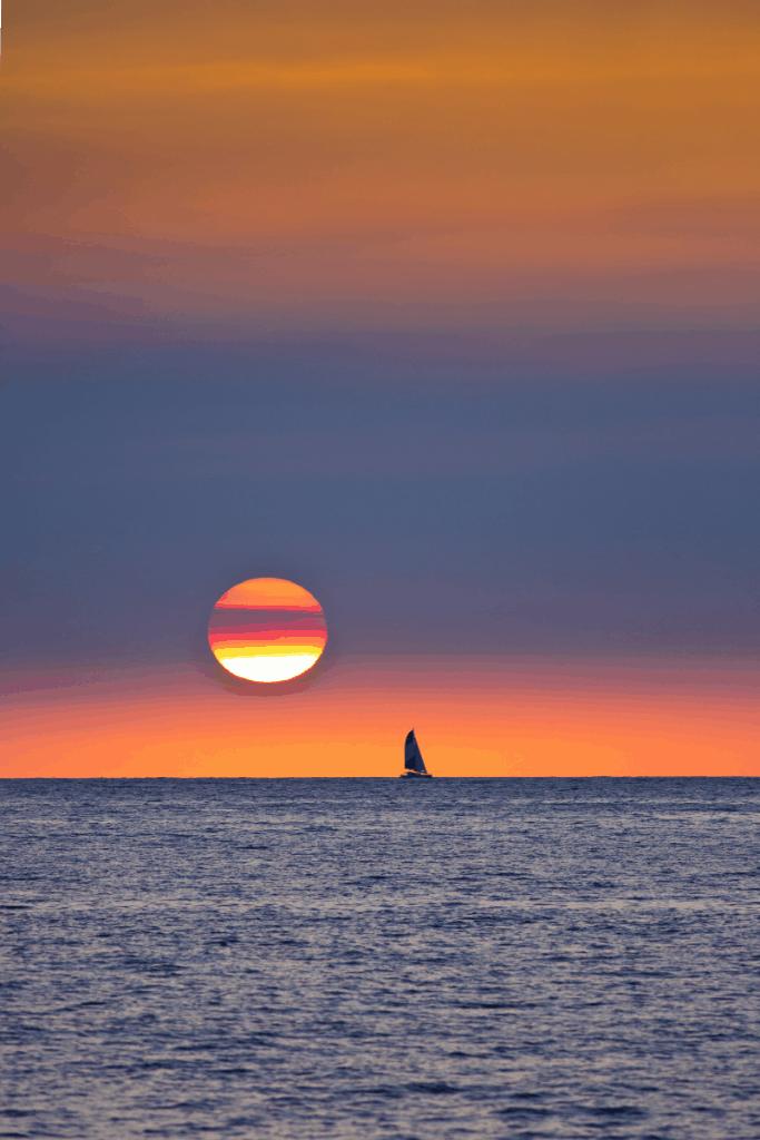 Sailboat at sunset in Kailua Kona Hawaii