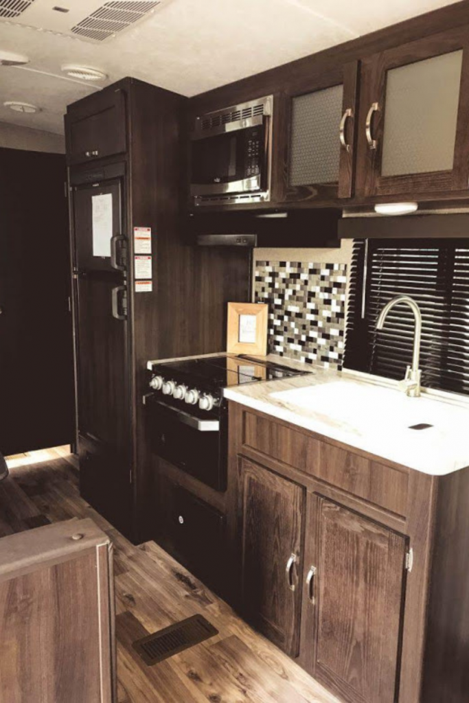 RV kitchen with small refrigerator