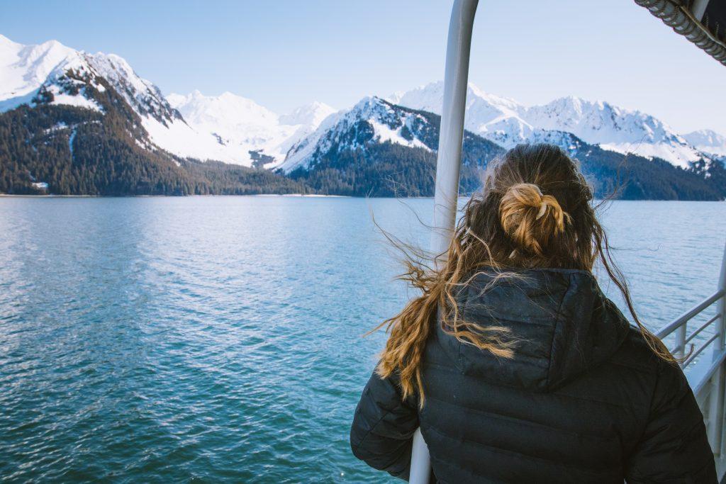 tourists enjoying a boat tour in seward alaska