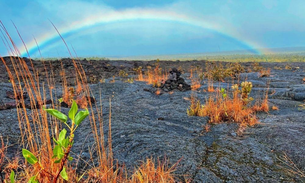 stunning rainbow in hawaii volcanoes national park